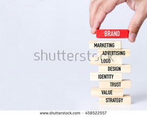 stock-photo-businessman-building-brand-concept-with-wooden-blocks-458522557